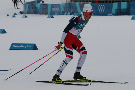 PYEONGCHANG, SOUTH KOREA - FEBRUARY 11, 2018: Olympic Champion  Johannes Hoesflot Klaebo of Norway competes at mass start in the Mens 15km + 15km Skiathlon at the 2018 Winter Olympic Games