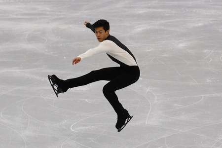 GANGNEUNG, SOUTH KOREA - FEBRUARY 16, 2018:  Nathan Chen of the United States  performs in the Men Single Skating Short Program at the 2018 Winter Olympic Games at Gangneung Ice Arena Editorial