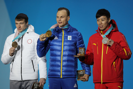 PYEONGCHANG, SOUTH KOREA FEBRUARY 19, 2018: Ilia Burov OAR (L), Olympic champion Oleksandr Abramenko UKR and Jia Zongyang CHN during medal ceremony in the Mens Aerials Freestyle Skiing in Medal Plaza 報道画像