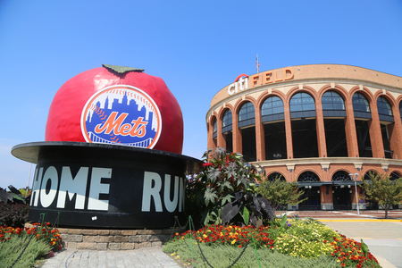 FLUSHING, NEW YORK - SEPTEMBER 5, 2017: The Famous Shea Stadium Home Run Apple on Mets Plaza in front of Citi Field, home of major league baseball team the New York Mets in Flushing, New York.