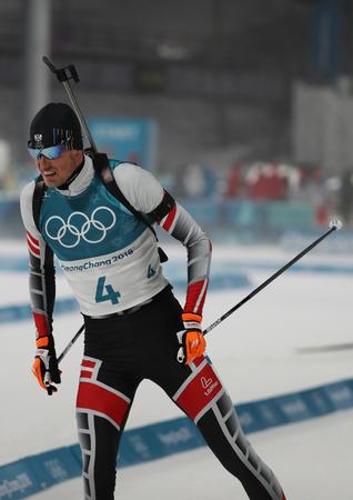 PYEONGCHANG, SOUTH KOREA - FEBRUARY 12, 2018: Julian Eberhard of Austria competes in biathlon mens 12.5km pursuit at the 2018 Winter Olympics in Alpensia Biathlon Centre