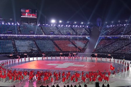 PYEONGCHANG, SOUTH KOREA - FEBRUARY 9, 2018: Olympic champion Dario Cologna carrying the flag of Switzerland leading the Swiss Olympic team at the PyeongChang 2018 Winter Olympic Games opening ceremony