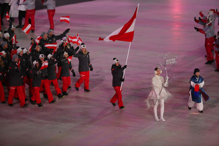 PYEONGCHANG, SOUTH KOREA - FEBRUARY 9, 2018: Olympic champion Anna Veith carrying the flag of Austria leading the Austrian Olympic team at the PyeongChang 2018 Winter Olympic Games opening ceremony Editorial