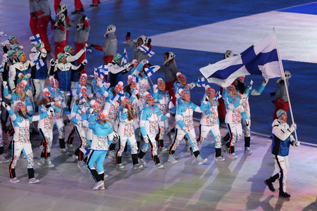 PYEONGCHANG, SOUTH KOREA - FEBRUARY 9, 2018: Janne Ahonyen carrying the flag of Finland leading the Finnish Olympic team at the PyeongChang 2018 Winter Olympic Games opening ceremony