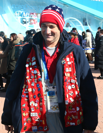 GANGNEUNG, SOUTH KOREA - FEBRUARY 17, 2018: Sport fan and pin collector in Gangneung Olympic Park during 2018 Winter Olympic Games