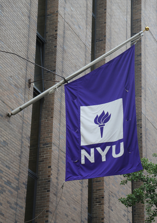 NEW YORK - JULY 11, 2017: NYU flag on David B. Kriser Dental Center in Lower Manhattan. NYU College of Dentistry is the third oldest continuously operating and the largest dental school in the USA Stock Photo - 100495696