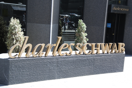 NEW YORK - APRIL 26, 2018: Charles Schwab Midtown Manhattan Branch at Avenue of the Americas. The Charles Schwab Corporation Provides Brokerage, Banking and Financial Services