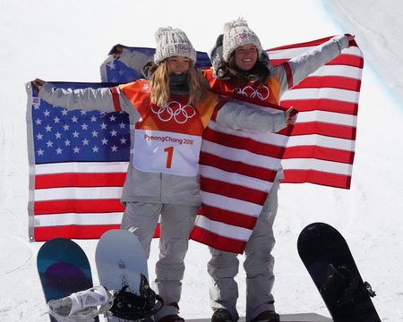 PYEONGCHANG, SOUTH KOREA - FEBRUARY 13, 2018: Olympic champion Chloe Kim (L) and Arielle Gold of USA during venue celebration after in the women`s snowboard halfpipe final at the 2018 Winter Olympics Sajtókép
