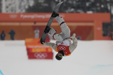 PYEONGCHANG, SOUTH KOREA - FEBRUARY 14, 2018: Jake Pates of the United States competes in the mens snowboard halfpipe final at the 2018 Winter Olympics in Phoeinix Snow Park