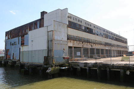 NEW YORK - MAY 3, 2018: Abandoned Fulton Fish Market on South Street Seaport in Manhattan. Since 1822 the Fulton Fish Market is America's oldest fish market. In 2005 Fulton Fish Market moved to Bronx.