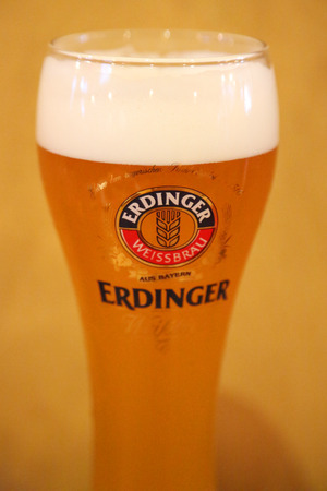 NEW YORK - MAY 3, 2018: A glass of German wheat beer Erdinger hefeweizen served in New York's restaurant Editorial