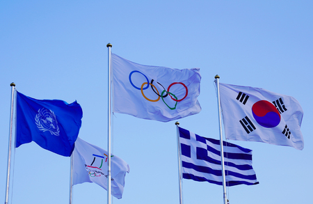 PYEONGCHANG, SOUTH KOREA - FEBRUARY 8, 2018: United Nations and Olympic Flags in the 2018 Winter Olympic Games Athletes Olympic Village in PyeongChang, South Korea