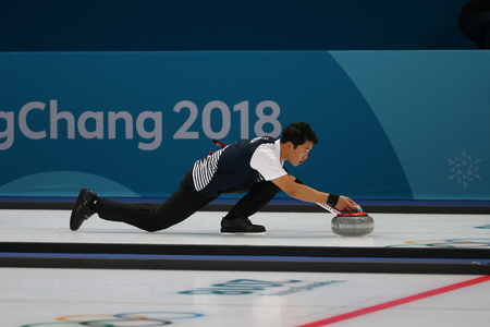 GANGNEUNG, SOUTH KOREA - FEBRUARY 10, 2018: Kijeong Lee of South Korea competes in the Mixed Doubles Round Robin curling match at the 2018 Winter Olympics