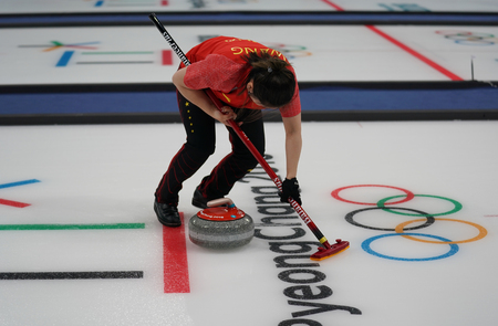 GANGNEUNG, SOUTH KOREA - FEBRUARY 10, 2018: Rui Wang of China competes in the Mixed Doubles Round Robin curling match at the 2018 Winter Olympics