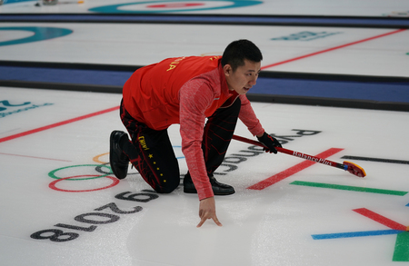 GANGNEUNG, SOUTH KOREA - FEBRUARY 10, 2018: Dexin Ba of China competes in the Mixed Doubles Round Robin curling match at the 2018 Winter Olympics