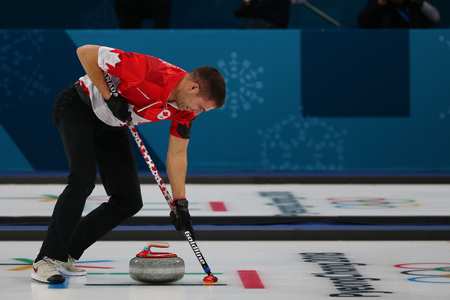 GANGNEUNG, SOUTH KOREA - FEBRUARY 10, 2018: Olympic Champion John Morris of Canada competes in the Mixed Doubles Round Robin curling match at the 2018 Winter Olympics