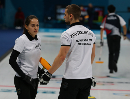 GANGNEUNG, SOUTH KOREA - FEBRUARY 10, 2018:Aleksandr Krushelnitskii and Anastasia Bryzgalova of Olympic Athlete from Russia compete in the Mixed Doubles Round Robin curling match at the 2018 Olympics