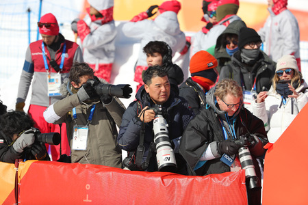 PYEONGCHANG, SOUTH KOREA - FEBRUARY 13, 2018: International sport photographers during photo shoot after the womens snowboard halfpipe final at the 2018 Winter Olympics in Phoenix Snow Park