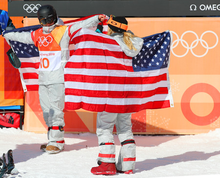PYEONGCHANG, SOUTH KOREA  FEBRUARY 13, 2018: Arielle Gold (L) and Chloe Kim of the USA celebrate victory in the women`s snowboard halfpipe final at the 2018 Winter Olympics in Phoenix Snow Park Sajtókép