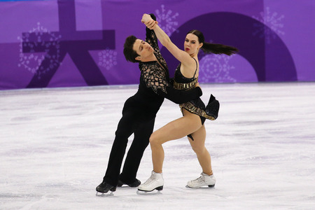 GANGNEUNG, SOUTH KOREA - FEBRUARY 11, 2018: Two times Olympic champions Tessa Virtue and Scott Moir of Canada perform in the Team Event Ice Dance Short  Dance at the 2018 Winter Olympic Games Editöryel