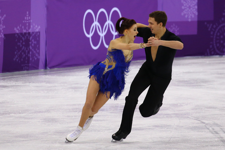GANGNEUNG, SOUTH KOREA - FEBRUARY 11, 2018: Ekaterina Bobrova and Dmitri Soloviev of Olympic Athlete from Russia perform in the Team Event Ice Dance Short Dance at the 2018 Winter Olympics