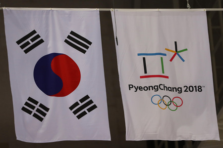 GANGNEUNG, SOUTH KOREA - FEBRUARY 12, 2018: South Korean and PyeongChang 2018 Olympics flags in Gangneung Ice Arena during the 2018 Winter Olympic Games Redactioneel
