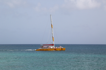 ST. JOHNS, ANTIGUA  - JUNE 13, 2018: Excursion catamaran at the Galley Bay in Antigua