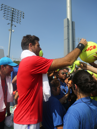 NEW YORK - AUGUST 26, 2017: Grand Slam Champion Juan Martin del Potro of Argentina signs autographs after practice for 2017 US Open at Billie Jean King National Tennis Center