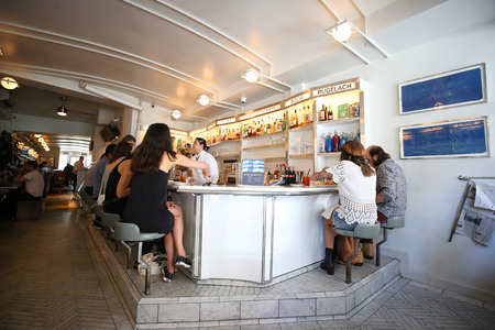 NEW YORK - JUNE 21, 2018: Famous Russ & Daughters cafe full of tourists and locals in Lower East Side in Manhattan