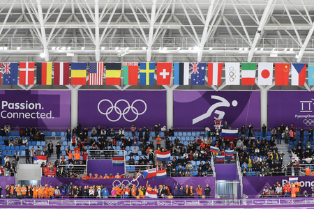 GANGNEUNG, SOUTH KOREA - FEBRUARY 16, 2018: International flags inside of the Gangneung Oval during the Ladies 5,000m Speed Skating at the 2018 Winter Olympic Games 에디토리얼
