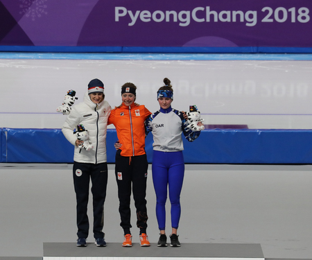 GANGNEUNG, SOUTH KOREA - FEBRUARY 16, 2018: Martina Sablikova CZE (L), Esmee Visser NLD and  Natalia Voronina OAR during venue ceremony after Ladies' 5,000m Speed Skating at the 2018 Winter Olympics Stockfoto - 104254620