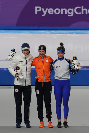 GANGNEUNG, SOUTH KOREA - FEBRUARY 16, 2018: Martina Sablikova CZE (L), Esmee Visser NLD and  Natalia Voronina OAR during venue ceremony after Ladies' 5,000m Speed Skating at the 2018 Winter Olympics Stockfoto - 104254622
