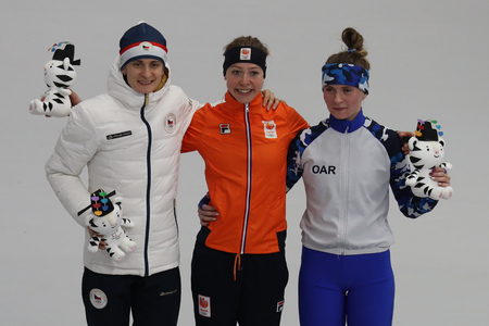 GANGNEUNG, SOUTH KOREA - FEBRUARY 16, 2018: Martina Sablikova CZE (L), Esmee Visser NLD and  Natalia Voronina OAR during venue ceremony after Ladies 5,000m Speed Skating at the 2018 Winter Olympics