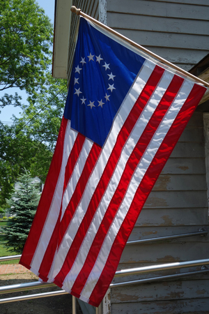 The first flag of the United States with 13-star. It is version of the Betsy Ross design Stock Photo