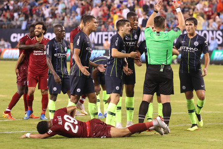 EAST RUTHERFORD, NJ - JULY 25, 2018: Dominic Solanke #29 of Liverpool FC lies on the ground after a hit during 2018 International Champions Cup game against Manchester City at MetLife stadium 에디토리얼