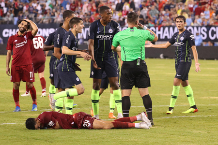 EAST RUTHERFORD, NJ - JULY 25, 2018: Dominic Solanke #29 of Liverpool FC lies on the ground after a hit during 2018 International Champions Cup game against Manchester City at MetLife stadium Redactioneel