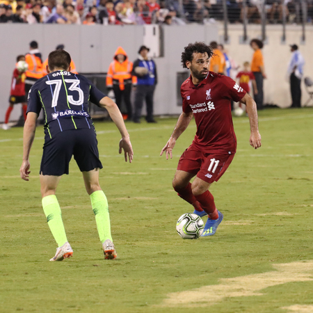 EAST RUTHERFORD, NJ - JULY 25, 2018: Mohammed Salah #11 of Liverpool FC in action against Manchester City during 2018 International Champions Cup game at MetLife stadium.