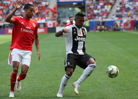 HARRISON, NJ - JULY 28, 2018: Alex Sandro of Juventus (R) and Tyronne Ebuehi of Benfica in action during the 2018 International Champions Cup game at Red Bull Stadium
