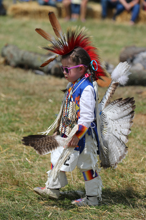 NEW YORK - JULY 29, 2018: Unidentified Young Native American during 40th Annual Thunderbird American Indian Powwow. A pow-wow is a gathering and Heritage Celebration of North America's Native People