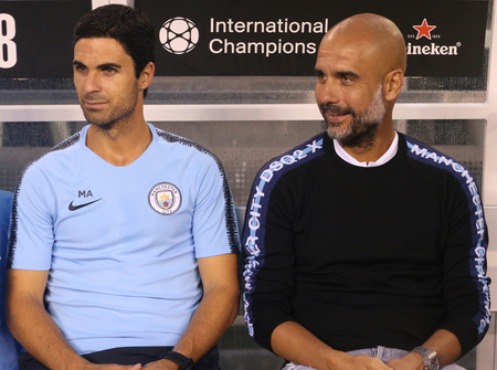 EAST RUTHERFORD, NJ - JULY 25, 2018: Mikel Arteta assistant coach (L) and Pep Guardiola manager of Manchester City during 2018 International Champions Cup game against Liverpool at MetLife stadium
