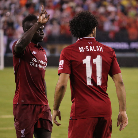 EAST RUTHERFORD, NJ - JULY 25, 2018: Sadio Mane (L) and Mohammed Salah #11 of Liverpool FC in action against Manchester City during 2018 International Champions Cup game at MetLife stadium