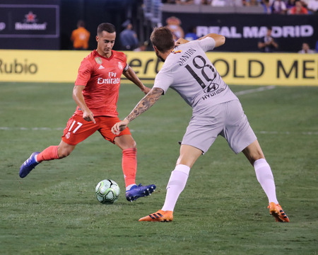EAST RUTHERFORD, NJ - AUGUST 7, 2018:Lucas Vazquez of Real Madrid #17 (L) and  Davide Sanson #18 of Roma in action in the 2018 International Champions Cup match at MetLife stadium. Real Madrid won 2-1