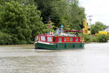 MACEDON, NEW YORK - JULY 20, 2018: A charter boat with vacationers on the Erie Canal in Upstate New York