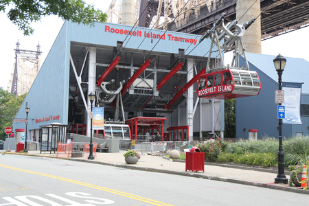 NEW YORK - AUGUST 9, 2018: The famous Roosevelt Island Tramway that spans the East River and connects Roosevelt Island to the Upper East Side of Manhattan Editorial