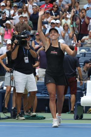 NEW YORK - AUGUST 30, 2018: Grand Slam champion Angelique Kerber of Germany celebrates victory after her 2018 US Open second round match at Billie Jean King National Tennis Center Éditoriale