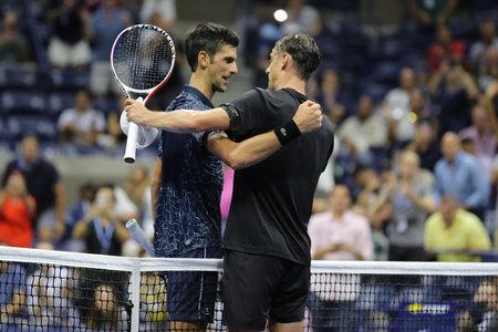 NEW YORK - SEPTEMBER 5, 2018: 13-time Grand Slam champion Novak Djokovic of Serbia (L) and  John Millman of Australia after 2018 US Open quarter-final match at Billie Jean King National Tennis Center