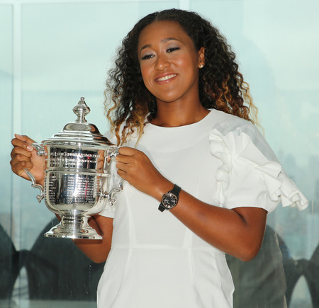 NEW YORK - SEPTEMBER 8, 2018: 2018 US Open champion Naomi Osaka of Japan poses with US Open trophy on the Top of the Rock Observation Deck at Rockefeller Center in New York