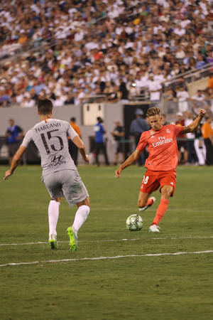 EAST RUTHERFORD, NJ - AUGUST 7, 2018: Marcos Llorente of Real Madrid #18 in action against Roma in the 2018 International Champions Cup match at MetLife stadium. Real Madrid won 2-1 Editorial