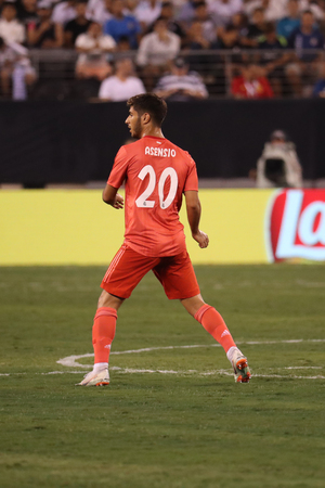 EAST RUTHERFORD, NJ - AUGUST 7, 2018: Marco Asensio of Real Madrid #20 in action during the 2018 International Champions Cup match against Roma at MetLife stadium. Real Madrid won 2-1