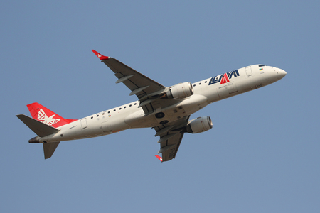 JOHANNESBURG, SOUTH AFRICA - SEPTEMBER 27, 2018: LAM Mozambique Airlines Embraer ERJ-190AR takes off from O. R. Tambo International Airport in Johannesburg, South Africa Editorial